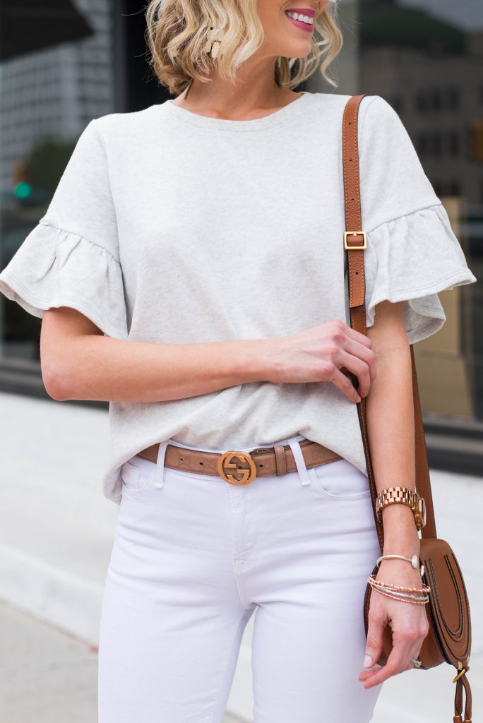 grey top with white jeans and gucci belt