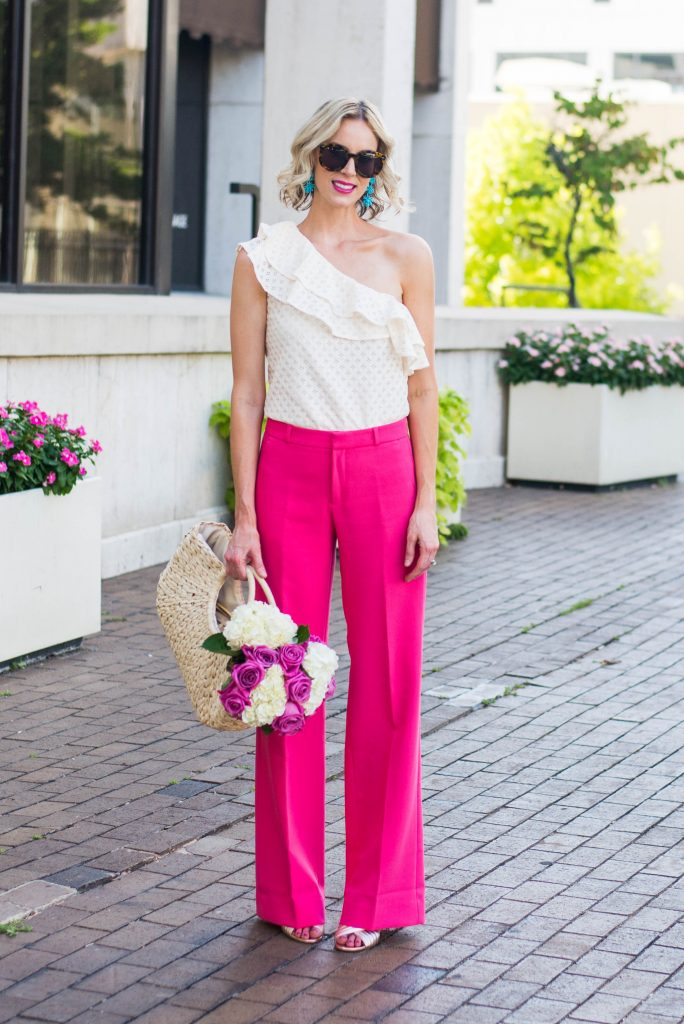 cream lace one shoulder ruffle top with pink trouser pants