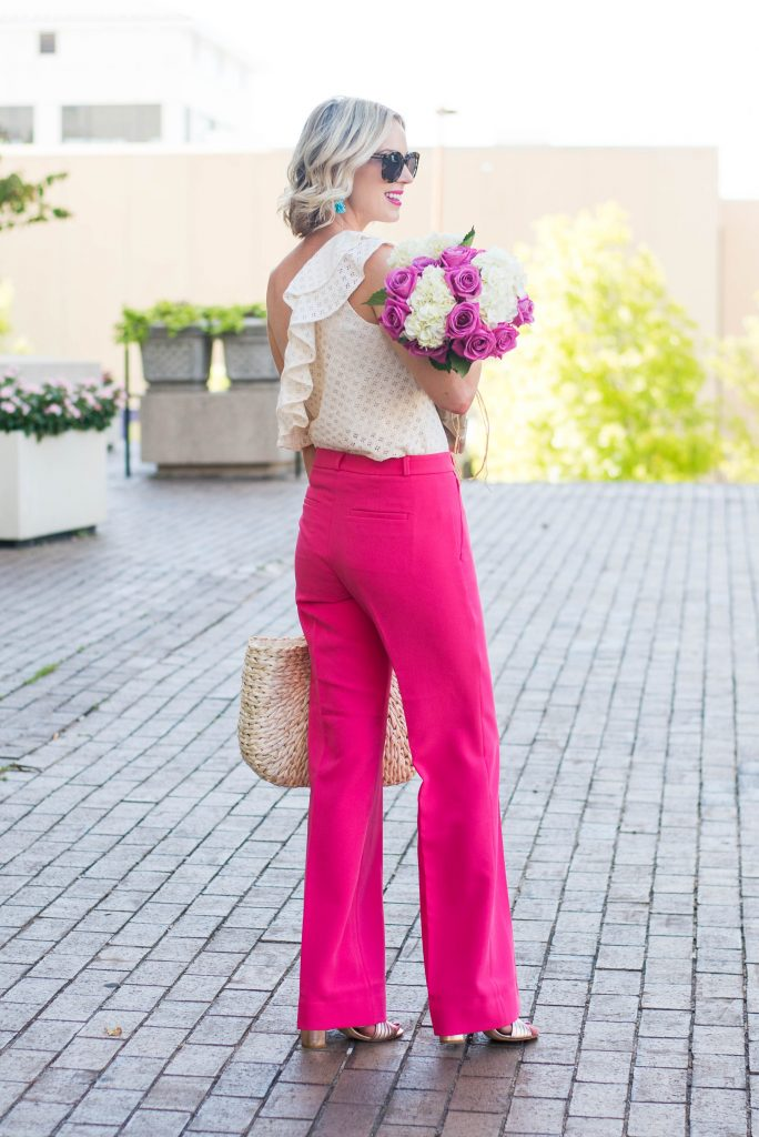 long wide leg pink pants with one shoulder blouse