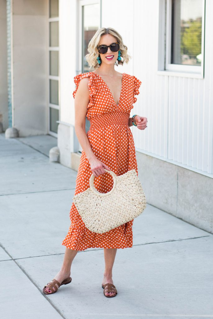 orange dress with turquoise accessories