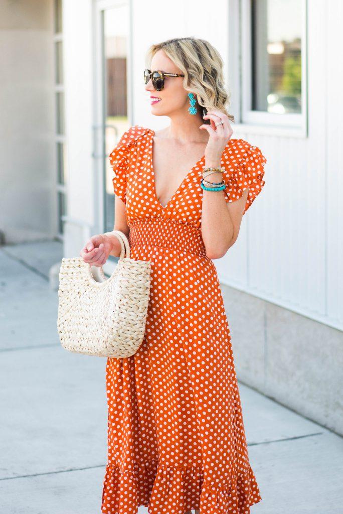 turquoise statement earrings with fun orange dress
