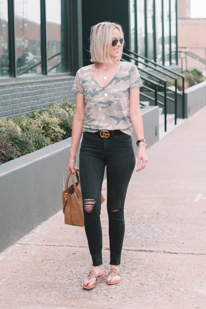 camo t-shirt and black jeans