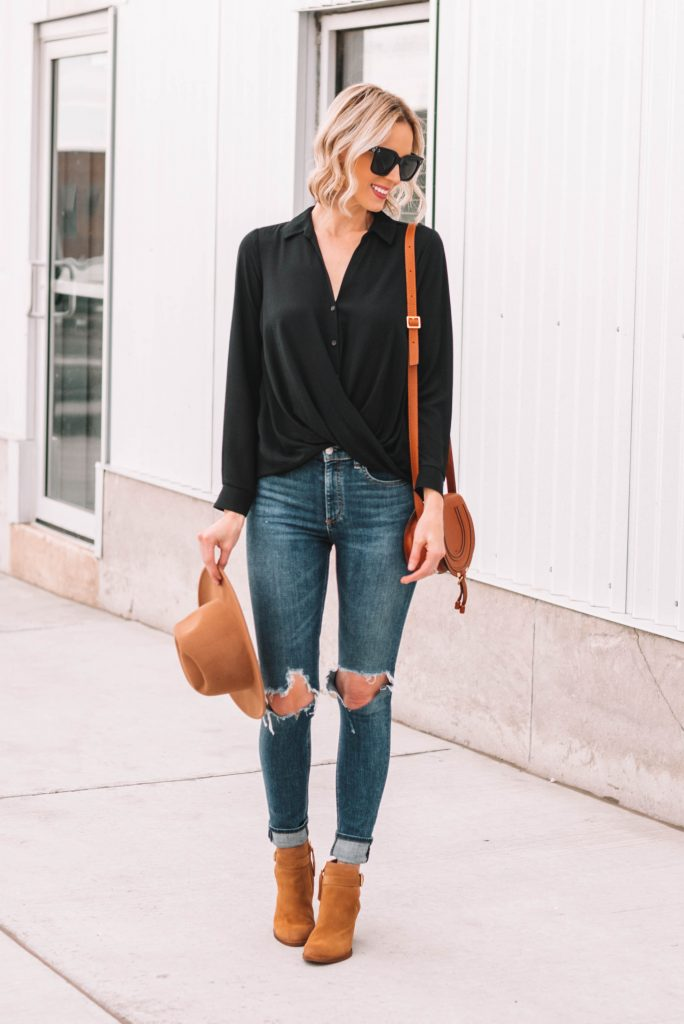 black blouse with tan booties and bag for fall