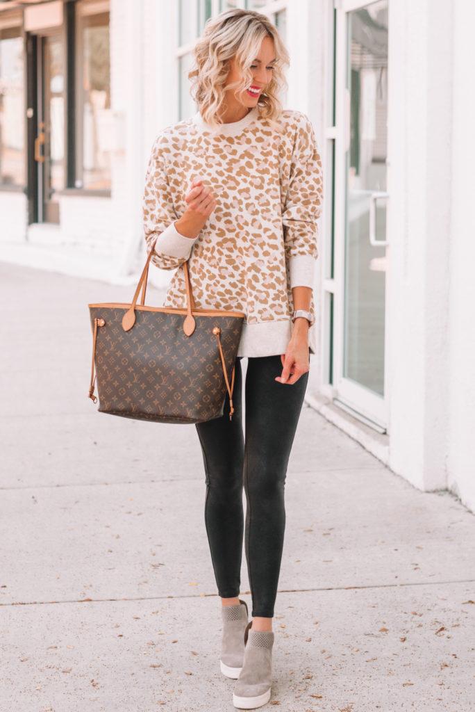 leopard sweatshirt won with faux leather leggings, how to wear leather leggings