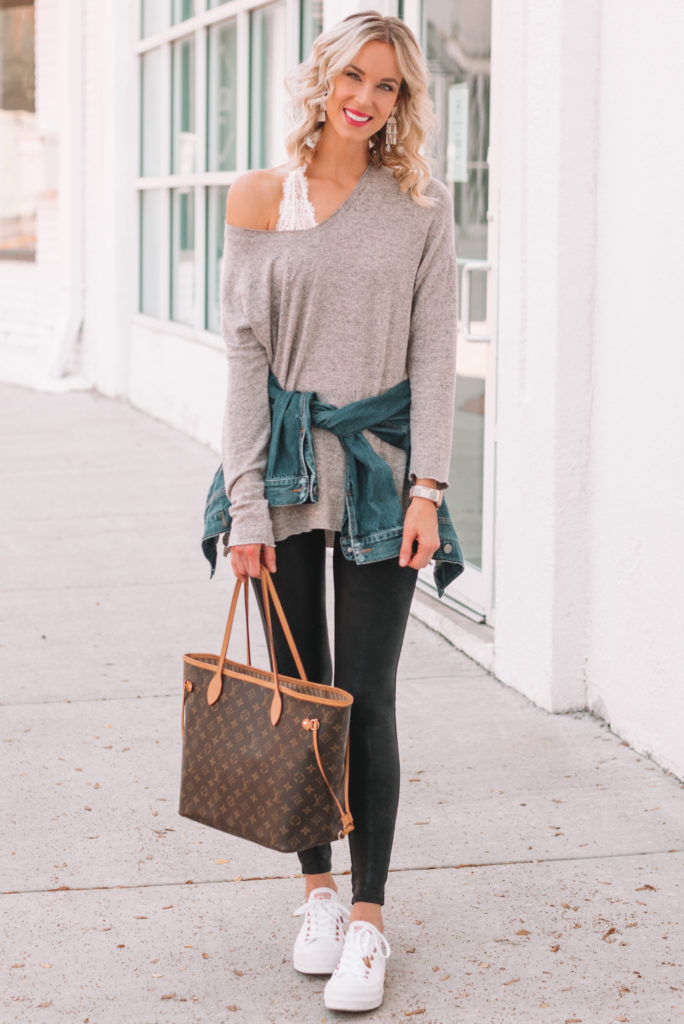 leather leggings worn casually with a tunic top and sneakers, leather legging outfit ideas