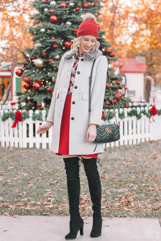 grey fur collar coat, red skirt, over the knee boots