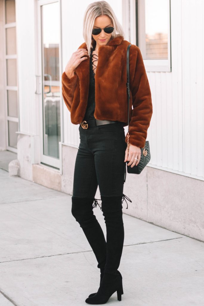 all black with faux fur brown jacket