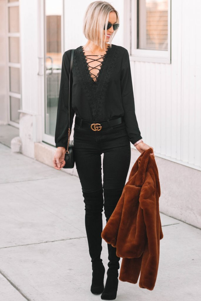 blonde bob haircut, all black outfit, lace up plunge top, gucci belt