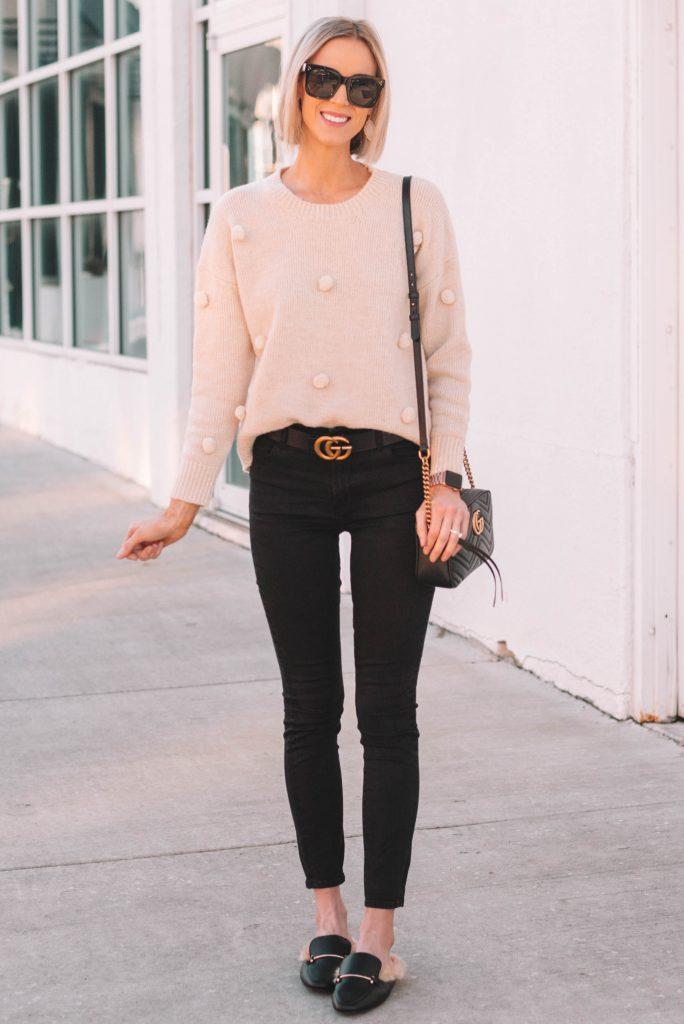 pom pom sweater, black jeans, slides