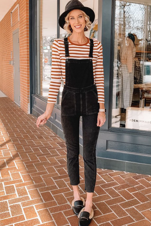 how to wear overalls - styling tips and trick for wearing overalls without looking like a farmer, skinny black overalls with striped shirt