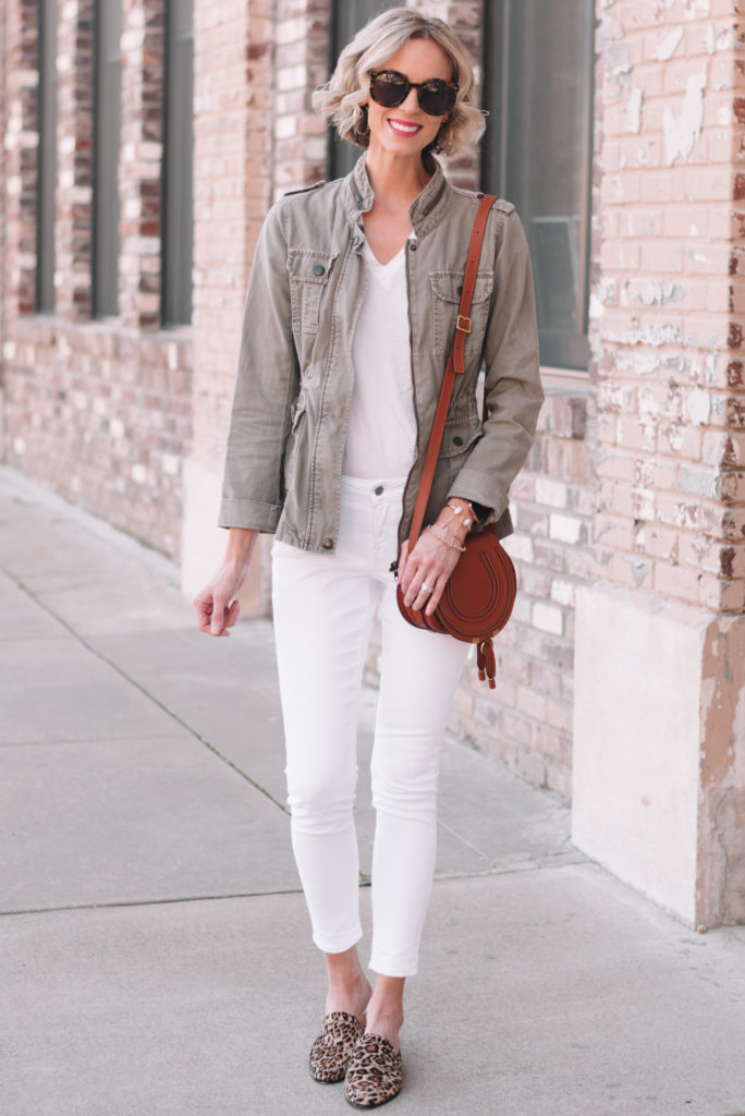 all white outfit with utility jacket and white jeans