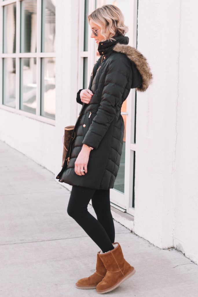 the best time to buy good quality coats for winter, black puffer coat with leggings and short brown UGGS