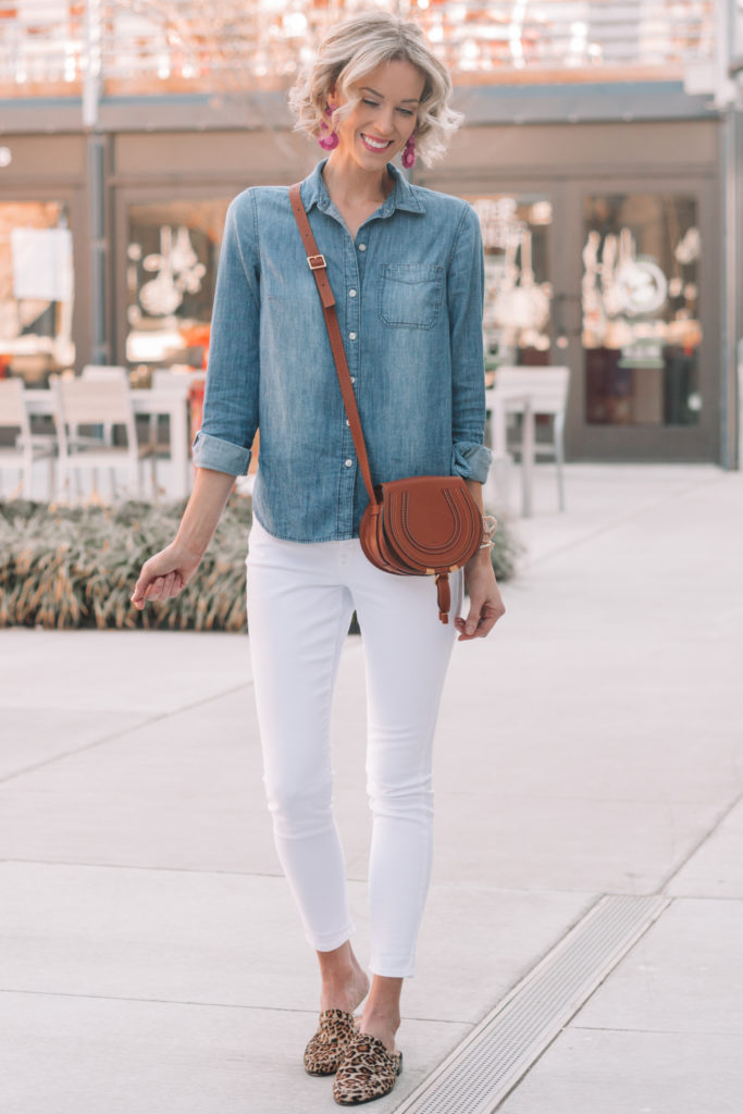 When trying to decide how to wear a chambray shirt, you can always pair it with one of your colored jean options like white or black for a contrast to the denim.