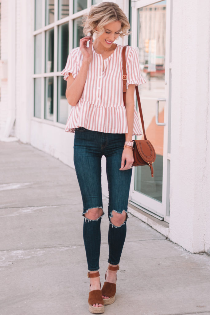 pink and white striped peplum top with jeans and wedges