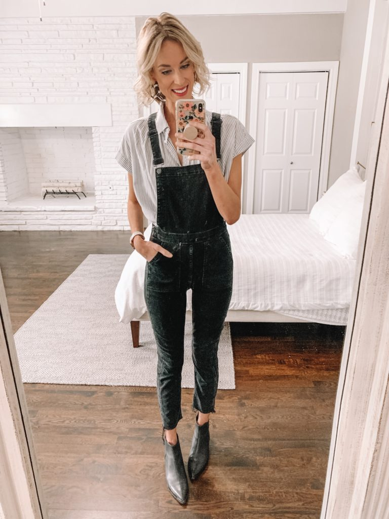 black skinny overalls worn with button up top and black flat ankle boots
