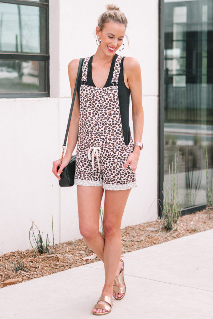 leopard soft overalls with black tank top and topknot, casual summer outfit