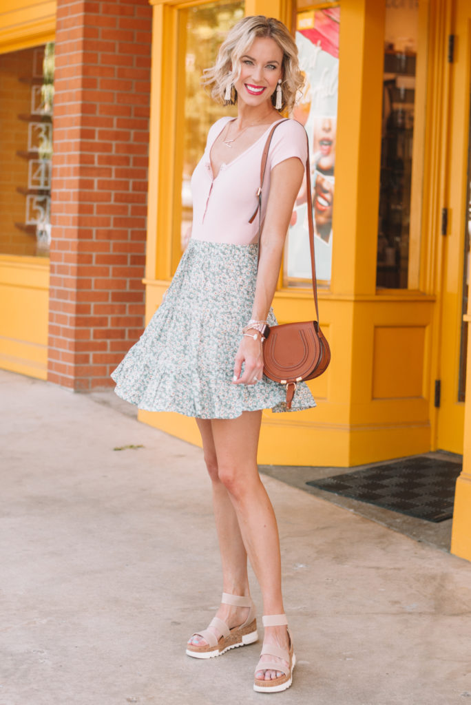 green floral skirt with henley bodysuit and neutral sandals