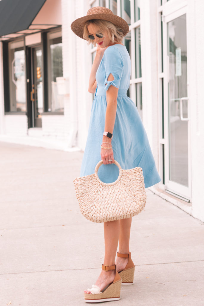 blue midi dress for summer with button front and sleeve tie detail