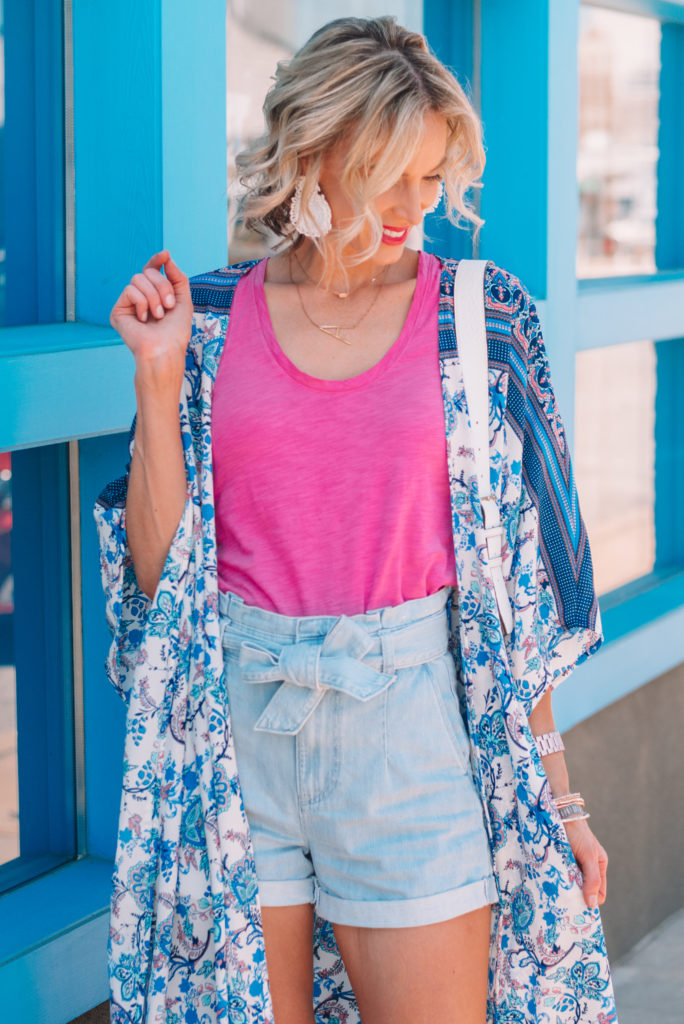 bright pink tank top with tie waist shorts and colorful kimono