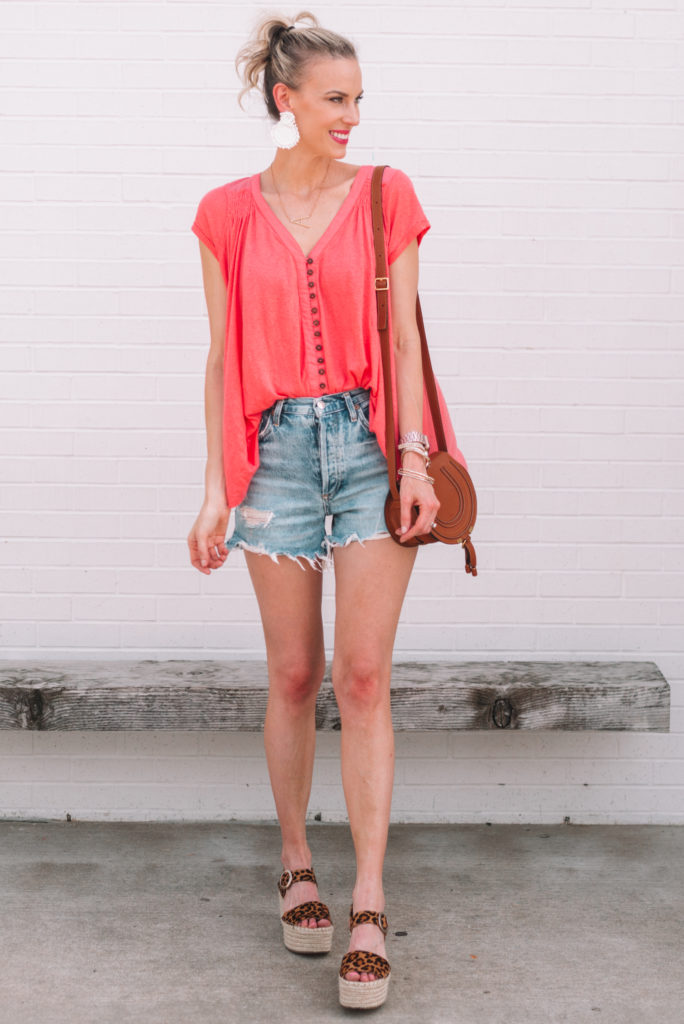 watermelon colored long tunic t-shirt with cutoff shorts and leopard espadrille shoes