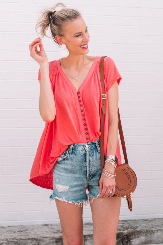 high ponytail with shirt hair, free people tunic flowy shirt, cutoff shorts