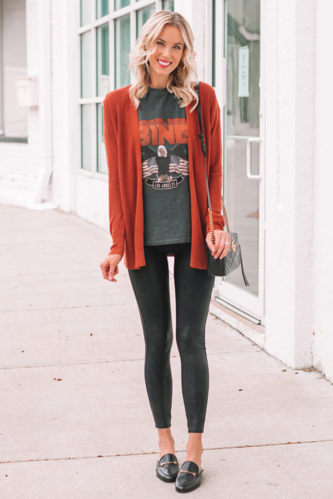 graphic t-shirt with faux leather leggings, cardigan, and loafers