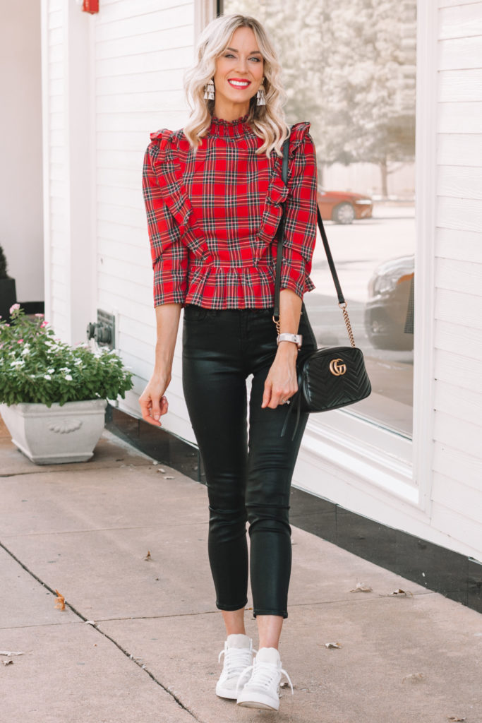 black skinny jeans with cropped length and red plaid top for fall