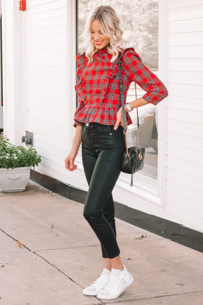 black coated jeans with red plaid top and high top shoes