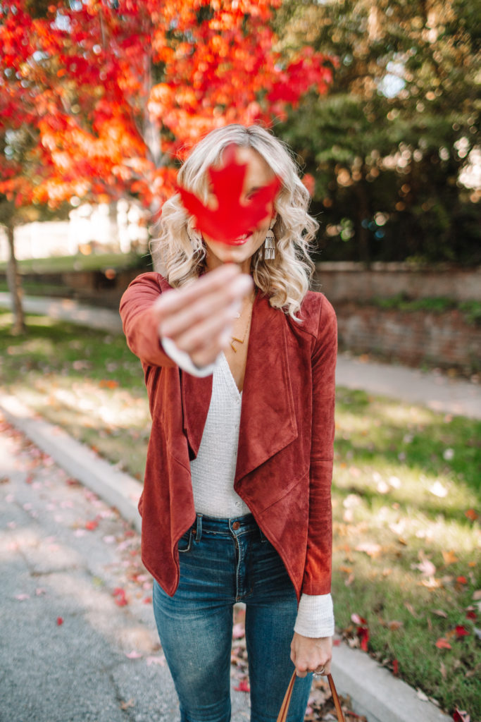 red fall leaves with fall outfit
