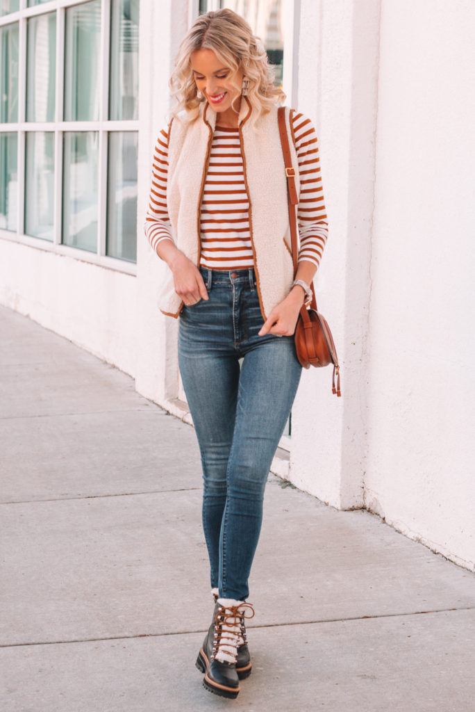 jeans and vest outfit, sherpa vest, skinny jeans, hiker boots