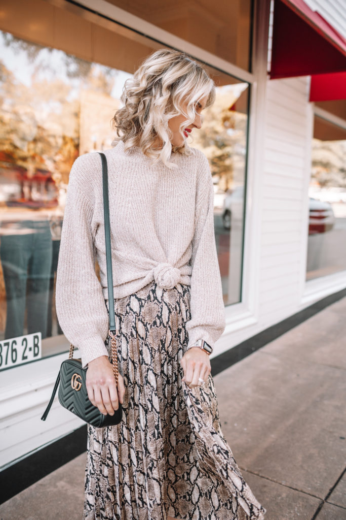 how to wear a midi skirt, snakeskin midi skirt, winter midi skirt outfit, knotted sweater with pleated midi skirt