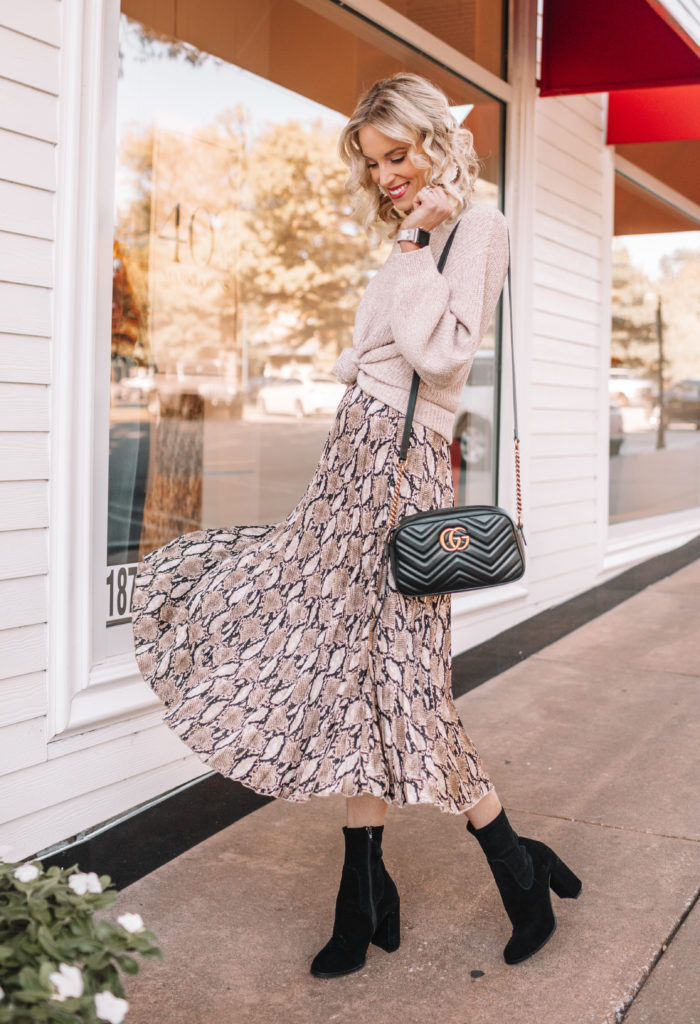 how to wear a midi skirt, snakeskin midi skirt, winter midi skirt outfit, knotted sweater with pleated midi skirt, midi skirt and boots outfit