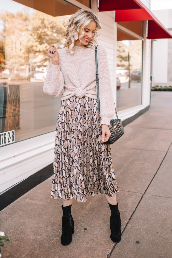 how to wear a midi skirt, snakeskin midi skirt, winter midi skirt outfit, knotted sweater with pleated midi skirt, midi skirt and boots outfit, pleated midi skirt
