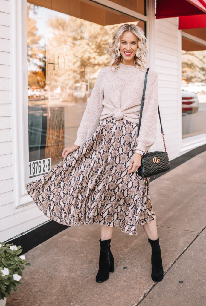 how to wear a midi skirt, snakeskin midi skirt, winter midi skirt outfit, knotted sweater with pleated midi skirt, midi skirt and boots outfit, 10 ways to wear a midi skirt