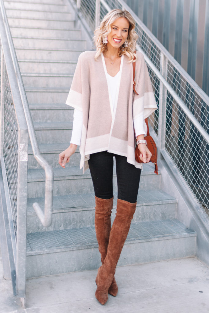 cute Thanksgiving outfit idea, neutral wrap style poncho