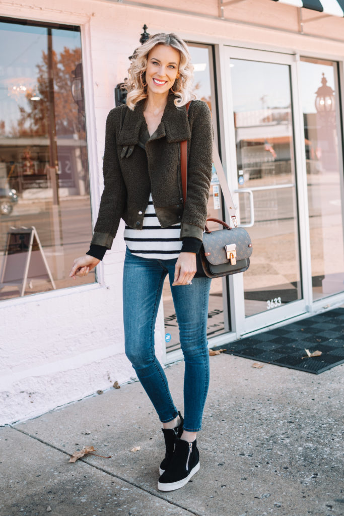 olive green sherpa jacket and black and white striped shirt