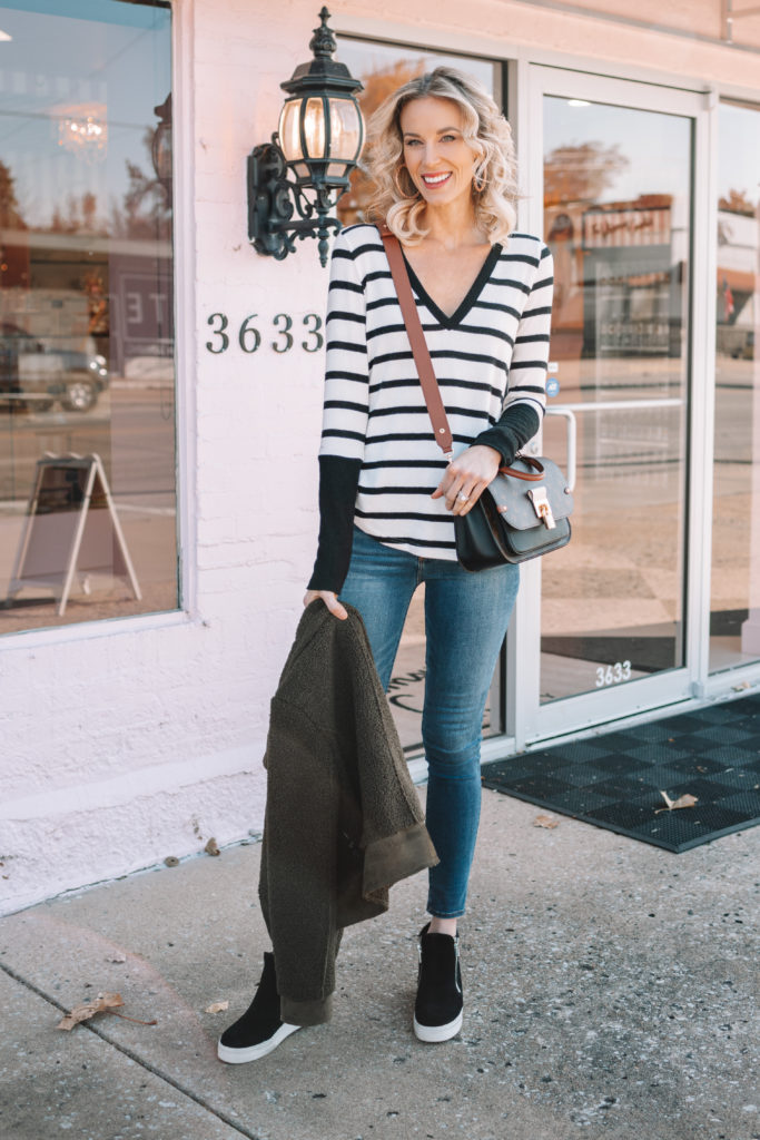 soft and cozy black and white striped shirt with black wedge sneakers