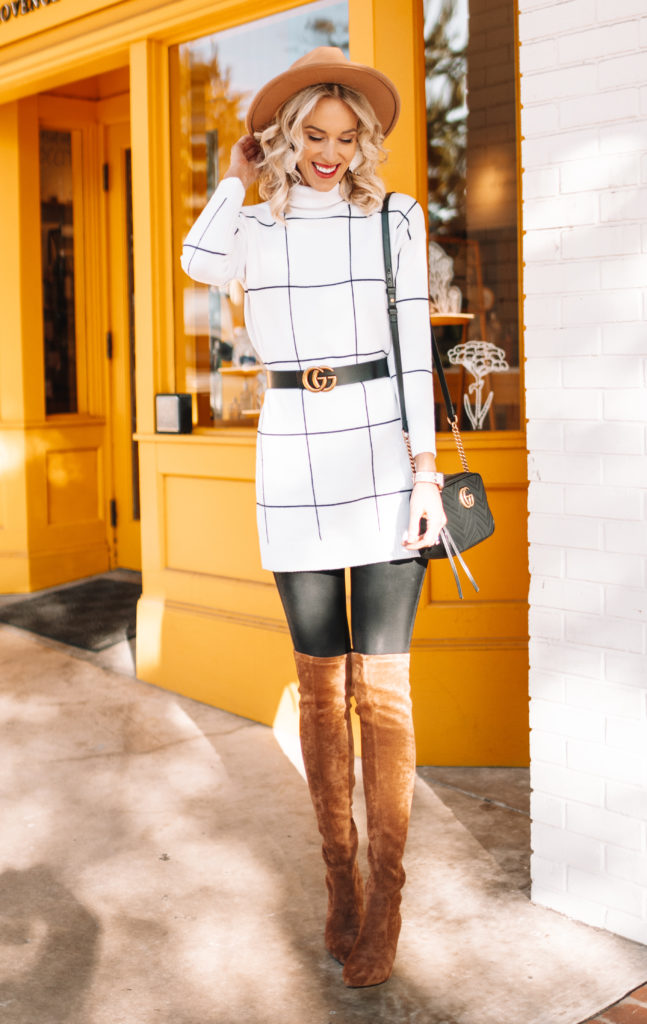 sweater dress and over the knee boots with leather leggings