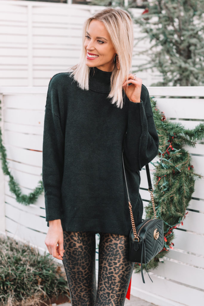 black tunic sweater and leopard leggings
