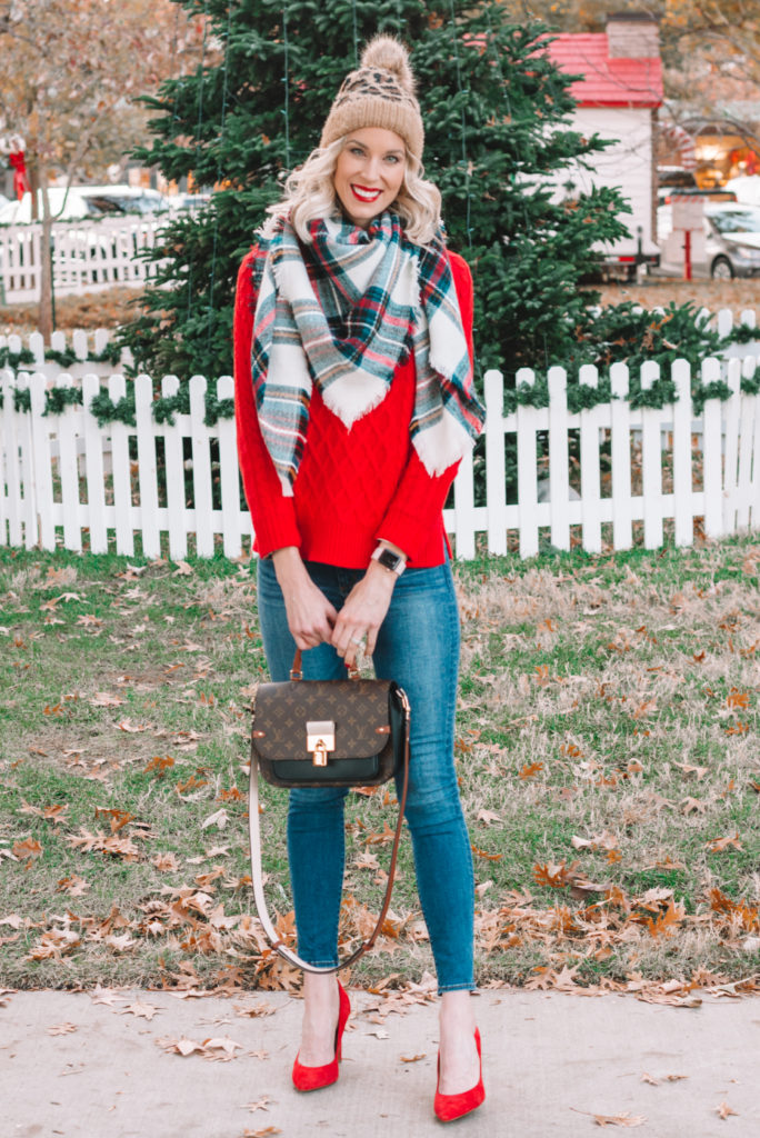 red sweater with leopard beanie