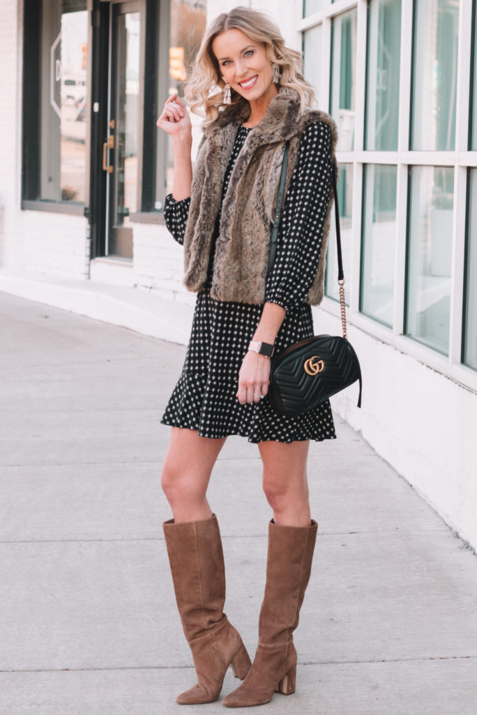 adorable ruffle hem dress with tall boots and faux fur vest