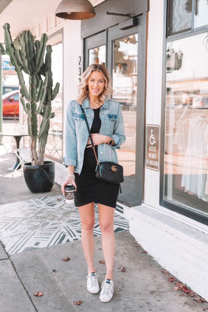 flattering black ruched dress, jean jacket, Golden Goose sneakers, Golden Goose dress outfit