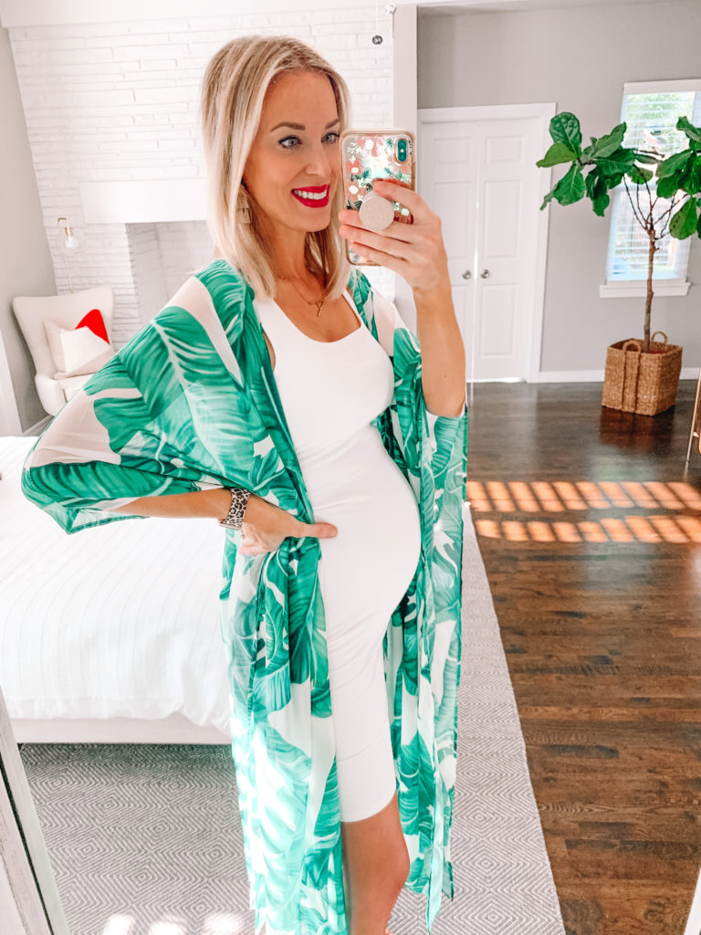 This non-maternity fitted dress has been my jam for pregnancy. It's super flattering and stretchy. I love this white dress with my palm print kimono. If you're looking for ideas on how to dress while pregnant, look no further!