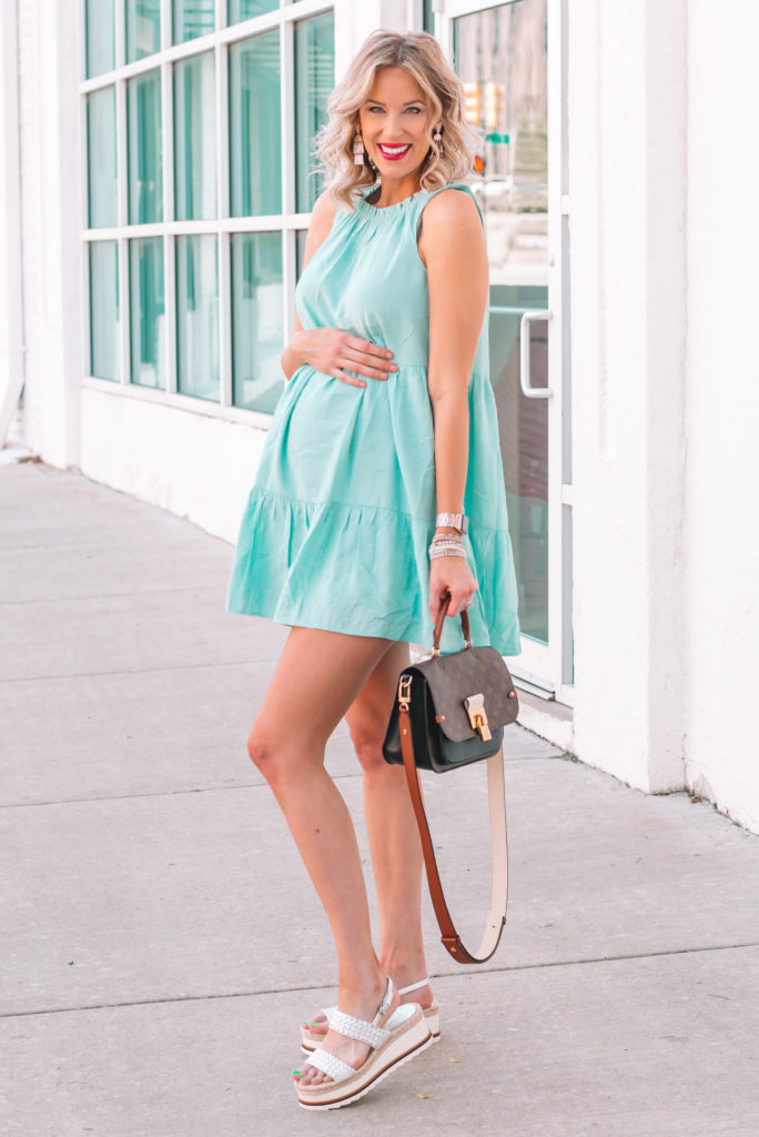 This tiered mint swing dress is so easy to wear and cool for summer. It's non-maternity but easy to wear with a bump too!