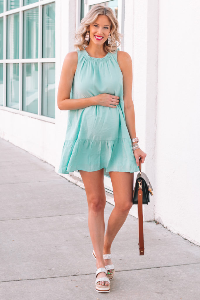 I have loved swing dresses during pregnancy. They are perfect with a bump and will work afterward too! This tiered mint swing dress is no exception.