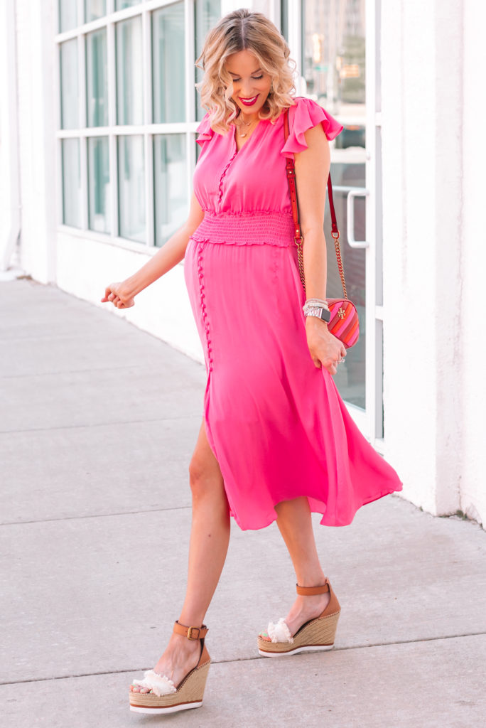 I love this pink dress with the flutter sleeves and smocked waist.