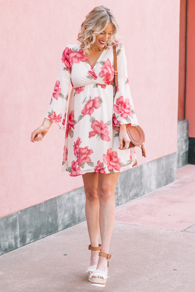 This floral chiffon dress is the perfect piece for spring and summer! Dress it up with wedges or down with flat sandals.