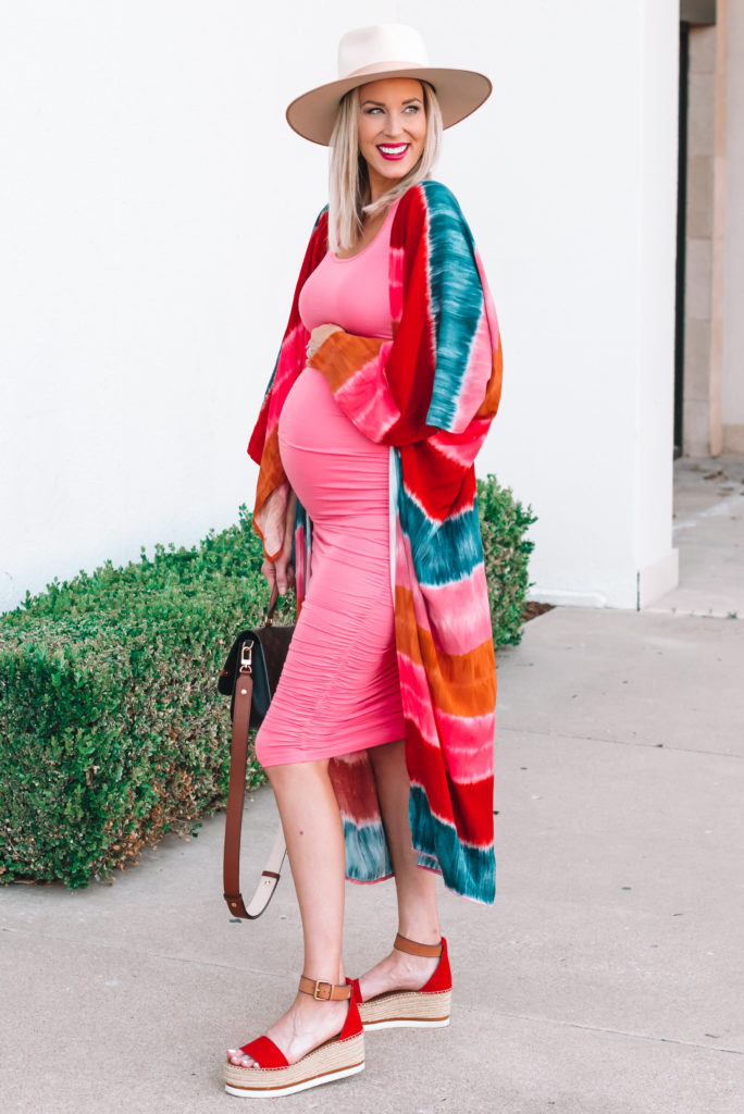 This pink ruched maternity dress is so much fun and very flattering! I love the slightly longer length and how easy it is to pair with so many things.