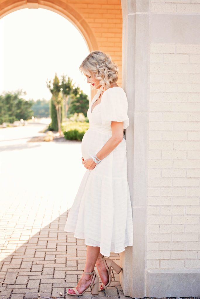 I am so grateful for these maternity photos to capture our sweet miracle girl. I wore this white midi dress for family photos and loved it.