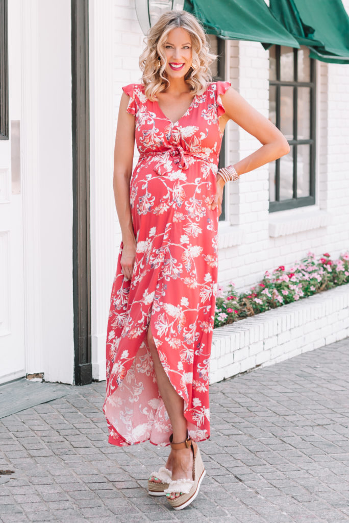 How gorgeous is this floral maternity wrap dress with the tulip hem and flutter sleeves?!